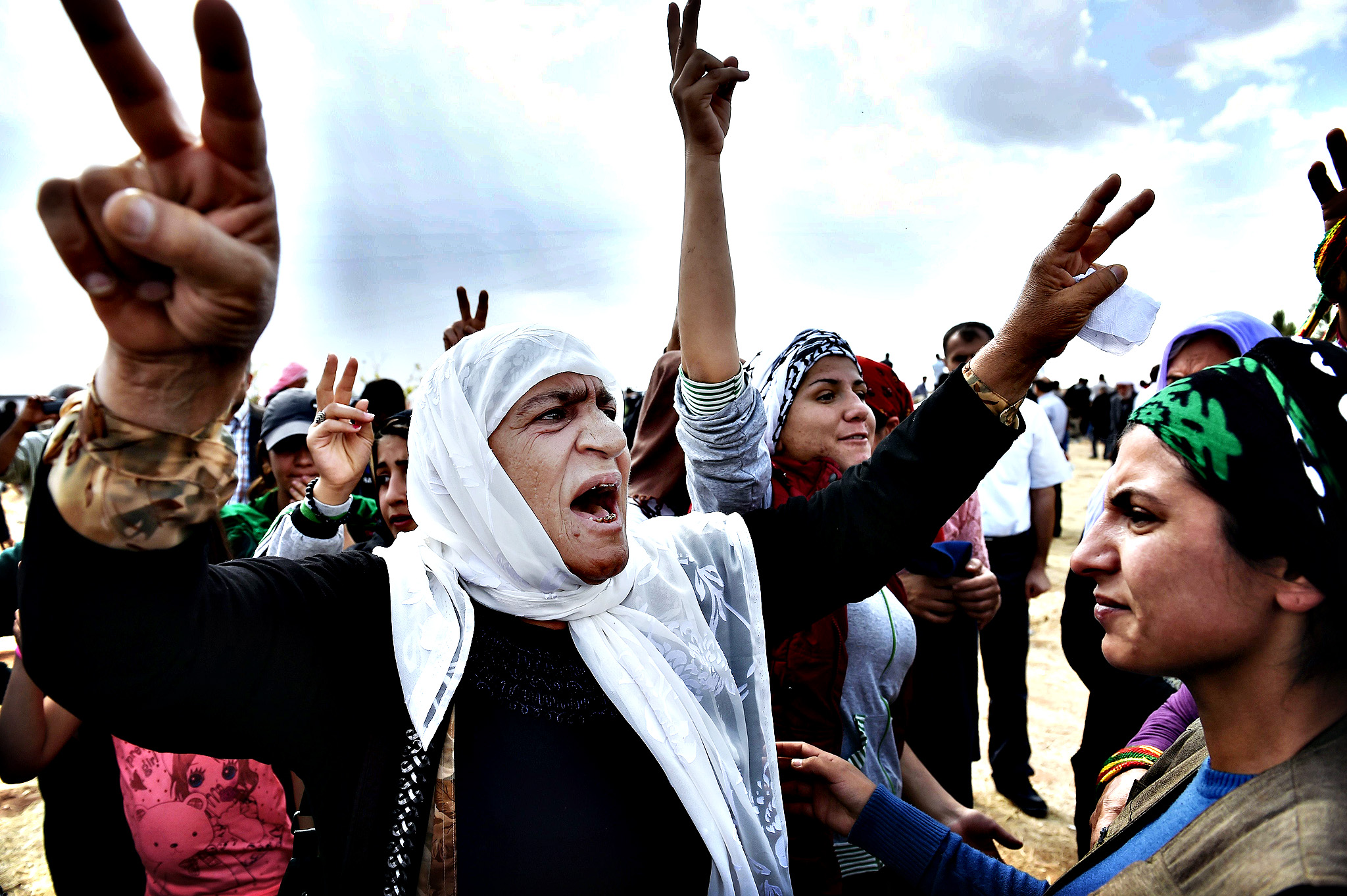 Kurdish women shout slogans during the f...Kurdish women shout slogans during the funeral of a  YPG (People's Protection Units) fighter in the town of Suruc, Sanliurfa province, on October 14, 2014. Attacking Islamic State jihadists met firm Kurdish resistance in the Syrian battleground town of Kobane on Sunday, as neighbouring Turkey heeded pressure to intervene and handed the US access to its air bases. AFP PHOTO / ARIS MESSINISARIS MESSINIS/AFP/Getty Images